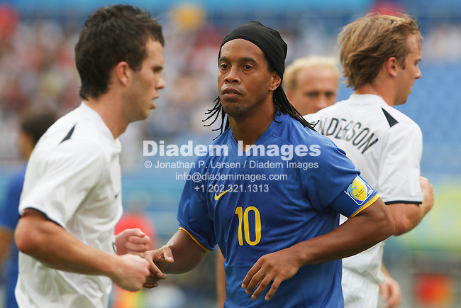 SHENYANG, CHINA - AUGUST 10:  Brazil team captain Ronaldhino in action during an Olympic football tournament Group C match against New Zealand August 10, 2008 at Shenyang Olympic Sports Center Stadium in Shenyang, China.  Editorial use only.  (Photography by Jonathan P. Larsen)
