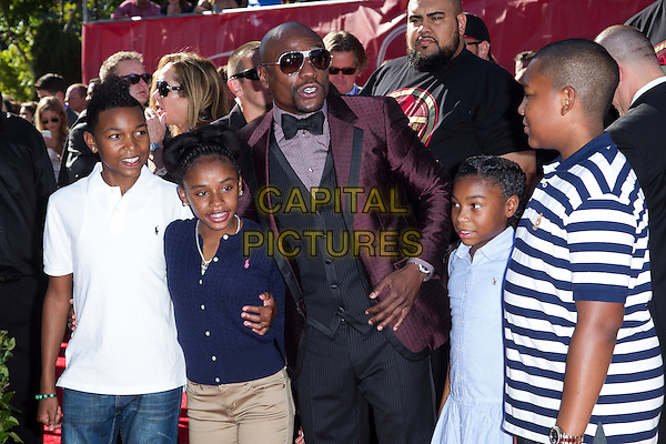 LOS ANGELES, CA - JULY 16: Floyd Mayweather Jr. &amp; guests at the 2014 ESPYs at Nokia Theatre L.A. Live in Los Angeles, California on July 16th, 2014.   <br /> CAP/MPI/mpi99<br /> &copy;mpi99/MediaPunch/Capital Pictures