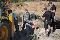 Pictured: Forensics officers examine fragments of what are believed to be pieces of an ancient urn during their preliminary search of the new site in Kos, Greece. Friday 07 October 2016<br />Re: Police teams led by South Yorkshire Police, searching for missing toddler Ben Needham on the Greek island of Kos have moved to a new area in the field they are searching.<br />Ben, from Sheffield, was 21 months old when he disappeared on 24 July 1991 during a family holiday.<br />Digging has begun at a new site after a fresh line of inquiry suggested he could have been crushed by a digger.