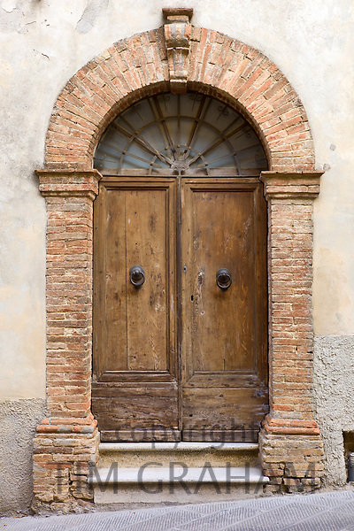 Traditional doorway in old hill town of Montalcino, Val D'Orcia,Tuscany, Italy