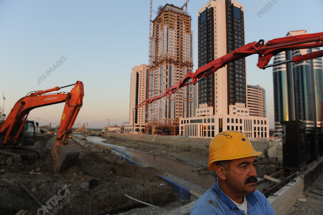 A Turkish worker stood on the site of Grozny City, a new project of skyscrapers being constructed by a Turkish company that is due for completion in October 201 in central Grozny, the Chechen capital. Huge amounts of Grozny have been completely rebuilt in the last few years and the city which was once brutally scarred by war now bears few traces of conflict. September 7, 2011