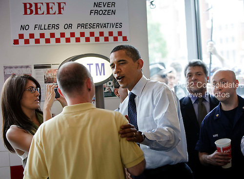 "Washington, DC - May 29, 2009 -- United States President Barack Obama visits with customers at a ""Five Guys"" burgers and fries restaurant Friday, May 29, 2009 in Washington, DC.  President Obama traveled with his motorcade to the burger restaurant in Southeast Washington.  .Credit: Brendan Smialowski - Pool via CNP"