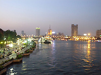 River view with riverboats in light on the Nile River in Cairo, Egypt