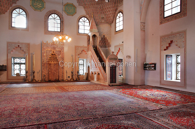 Prayer hall with minbar or pulpit and mihrab, in the Gazi Husrev-beg Mosque, built 1530-32, Sarajevo, Bosnia and Herzegovina. The complex includes a maktab and madrasa (Islamic primary and secondary schools), a bezistan (vaulted marketplace)and a hammam. The mosque was renovated after damage during the 1992 Siege of Sarajevo during the Yugoslav War. Picture by Manuel Cohen