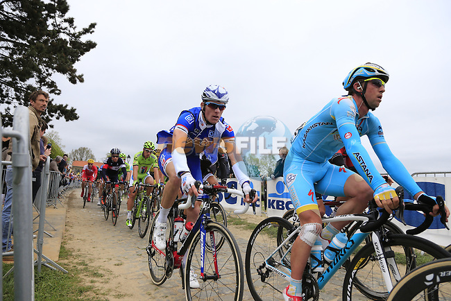 The chasing peleton, including Francesco Gravazzi (ITA) Astana, climb the Oude Kwaremont during the 2014 Tour of Flanders, Belgium.<br /> Picture: Eoin Clarke www.newsfile.ie