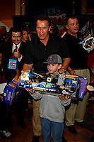 Arnold Schwarzenegger gives toys to children