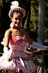 A girl dressed in a pink costume represents Bolivia in the Hispanic Parade in New York City