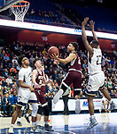 UNCASSVILLE, CT-031818JS10- Sacred Heart's Isiah Gaiter (2) puts up a shot after getting past Notre Dame-Fairfield's Josh Reaves (23) during their Division I championship game Sunday at Mohegan Sun Arena. <br /> Jim Shannon Republican-American