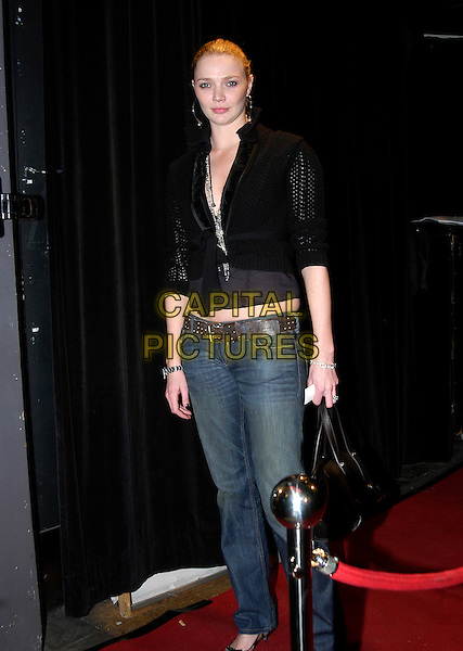 JODIE KIDD.British Harper's Bazaar - magazine launch party at Club Cirque, London, UK.February 16th, 2006.Ref: IA.full length black top cardigan jeans denim.www.capitalpictures.com.sales@capitalpictures.com.©Capital Pictures