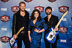 Charles Kelley, Hillary Scott, Dave Haywood of Lady Antebellum in the press room at the American Country Awards 2013 at the Mandalay Bay Resort & Casino in Las Vegas, Nevada