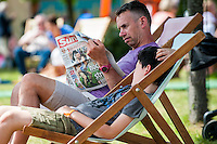 Tuesday  31 May 2016<br /> Pictured:  A man reads a copy of the Sun newspaper at hay. <br /> Re: The 2016 Hay festival take place at Hay on Wye, Powys, Wales