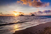 Lanikai Beach at sunrise, Kailua, O'ahu, with the Mokuluas in the distance.