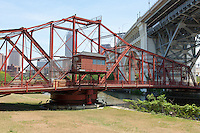 The Center Street Swing Bridge moves back into position after allowing a tanker to pass on the Cuyahoga River in Cleveland, Ohio.  The bridge carries vehicular traffic over the river from underneath the Veterans Memorial Bridge.