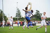 VOETBAL: OUDEGA (W): Sportpark It Joo, 17-07-2012, Oefenwedstrijd SC Heerenveen-Waasland Beveren (BEL), keeper Colin Coosemans (#26), Matthew Amoah (#14), ©foto Martin de Jong