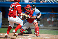 Auburn Doubledays catcher Andruth Ramirez #6 looks to tag out Patrick Wisdom #35 coming home as umpire Blake Carnahan looks on to make the call during a NY-Penn League game against the Batavia Muckdogs at Dwyer Stadium on September 3, 2012 in Batavia, New York.  Auburn defeated Batavia 5-3.  (Mike Janes/Four Seam Images)