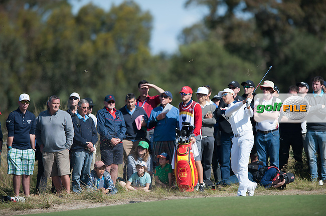 Li Haotong (CHN) during round 3 at the ISPS Handa World Cup of Golf, from Kingston heath Golf Club, Melbourne Australia. 26/11/2016<br /> Picture: Golffile | Anthony Powter<br /> <br /> <br /> All photo usage must carry mandatory copyright credit (&copy; Golffile | Anthony Powter)