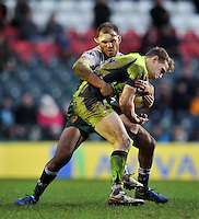 Will Addison of Sale Sharks is tackled by Lachlan McCaffrey of Leicester Tigers. Aviva Premiership match, between Leicester Tigers and Sale Sharks on February 6, 2016 at Welford Road in Leicester, England. Photo by: Patrick Khachfe / JMP