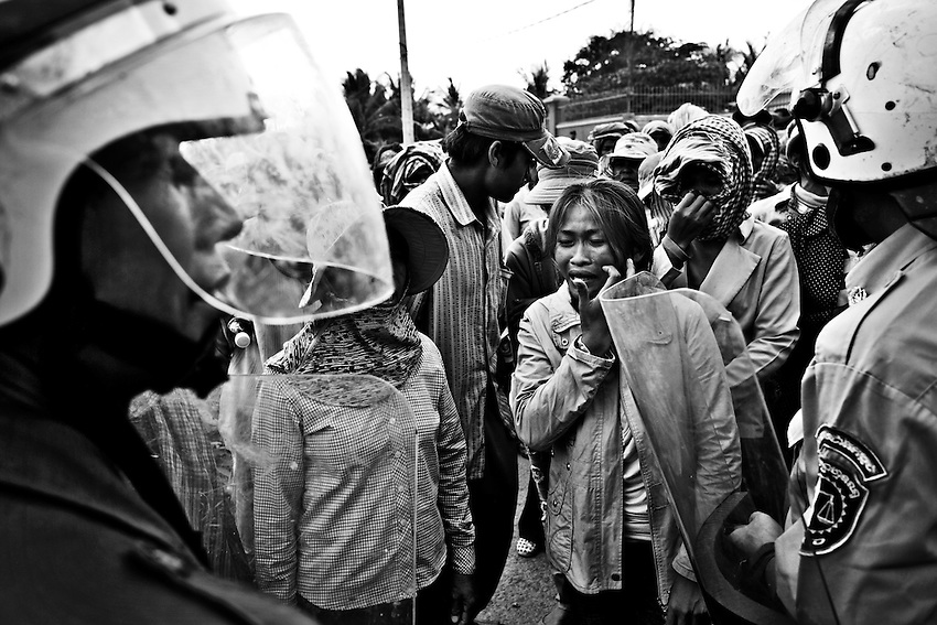 Villagers from Omlaing Commune in Kampong Speu province's Thpong district protest the arrest of village representatives You Tho and Khem Vouthy outside the Kampong Speu Provincial Court, March 24, 2010. The two were arrested for their alleged involvement in the torching of a makeshift office belonging to the Phnom Penh Sugar Company, which is owned by CCP Senator Ly Yong Phat. The company has been granted a 9,000-hectare land concession in Omlaing commune, which rights groups say could be in violation of Cambodia's Land Law if, as suspected, owner Ly Yong Phat is also the beneficiary of an adjacent 10,000-hectare land concession. Under the Land Law, concessions are limited to 10,000 hectares.