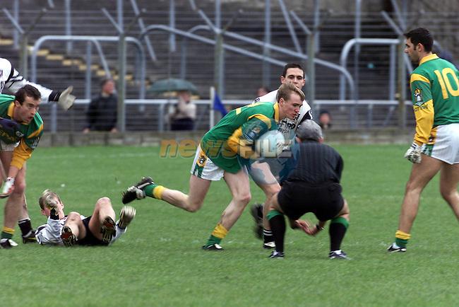 Meath's no 12 Damien Byrne fights off the Sligo Defence.Pic Fran Caffrey Newsfile.©Newsfile Ltd.
