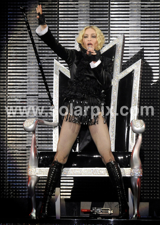 "**ALL ROUND PICTURES FROM SOLARPIX.COM**.**SYNDICATION RIGHTS FOR UK AND SPAIN ONLY**.Madonna on stage during her concert in the LTU arena in Duesseldorf. The concert in Duesseldorf was part of her spectacular ""Sticky and Sweet"" world tour..JOB REF:  7231    CPR / DDP       DATE: 05.09.08.**MUST CREDIT SOLARPIX.COM OR DOUBLE FEE WILL BE CHARGED* *UNDER NO CIRCUMSTANCES IS THIS IMAGE TO BE REPRODUCED FOR ANY ONLINE EDITION WITHOUT PRIOR PERMISSION*"