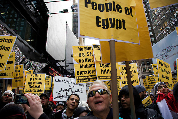 "Egyptians, Egyptian-Americans, and other supporters rally in Times Square for ""Day of Departure: New York Rallies for Egypt"" before marching to the Egyptian Mission to the United Nations on 04 February 2011 in New York City, New York. The event was planned to coincide with a huge demonstration in Cairo, Egypt, where President Hosni Mubarak continues to refuse to resign amid massive protests."
