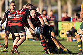 Federick Cain looks to get his pass away as he is tackled. Counties Manukau Premier Club Rugby game between Pukekohe and Papakura, played at Colin Lawrie Fields Pukekohe on Saturday June 9th 2018. Pukekohe won the game 37 - 22 after leading 15 - 10 at halftime. <br /> Photo by Richard Spranger.