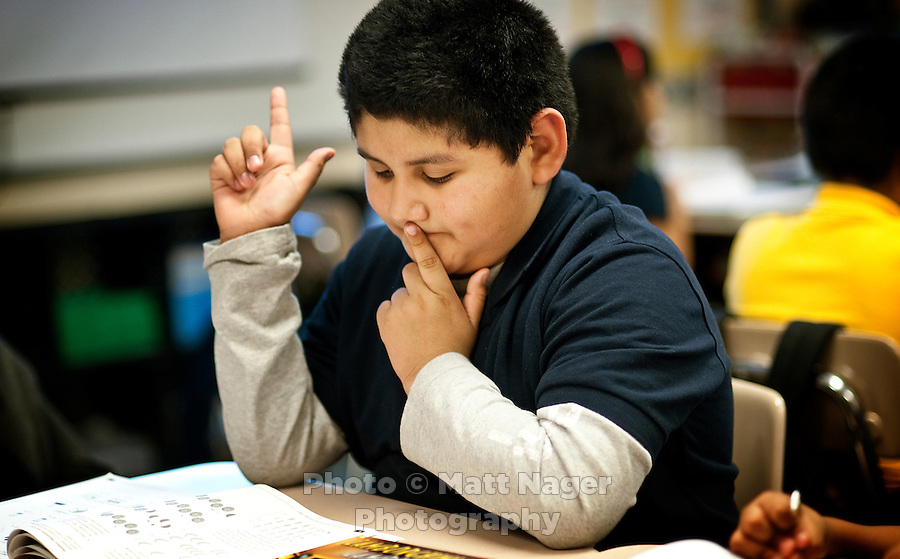 A student works on math during Gilda Martinez's third grade bi-lingual class at C. M. Macdonnell Elementary School in Laredo, Texas, US, Tuesday, Dec., 8, 2009. With over 95 percent of the population as Hispanic Spanish speakers, Laredo ranked the lowest in literacy rates in the 2000 US census. Today there are a number of bi-lingual and dual language classes set up to help students and adults learn english...PHOTOS/ MATT NAGER