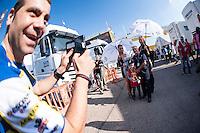 VALENCIA, SPAIN - NOVEMBER 8: Fans shoot a photo with Rizoma paddok girls  during Valencia MotoGP 2015 at Ricardo Tormo Circuit on November 8, 2015 in Valencia, Spain