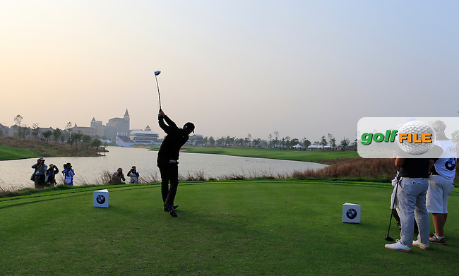 Jamie Donaldson (WAL) tees off the 18th tee during Sunday's Final Round of the 2014 BMW Masters held at Lake Malaren, Shanghai, China. 2nd November 2014.<br /> Picture: Eoin Clarke www.golffile.ie
