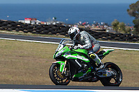 Federico Sandi (ITA) riding the Kawasaki ZX-10R (23) of the Pedercini Team exits turn 10 during a practise session on day two of round one of the 2013 FIM World Superbike Championship at Phillip Island, Australia. rounds turn 11 during a practise session on day two of round one of the 2013 FIM World Superbike Championship at Phillip Island, Australia.