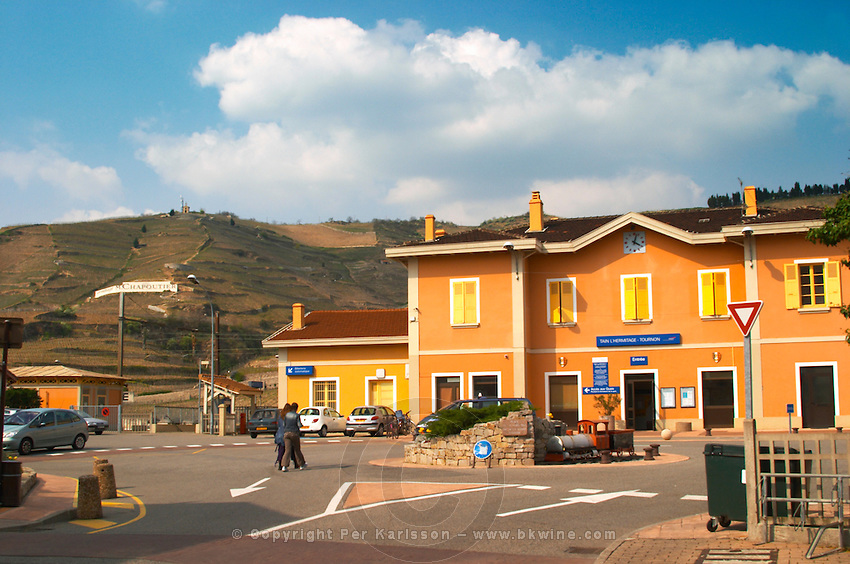 The SNCF railway station in Tain l'Hermitage-Tournon with the Hermitage hill in the background with terraced vineyards. Tain l'Hermitage, Drome, Drôme, France, Europe