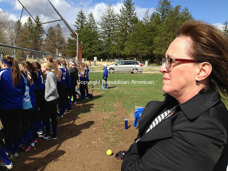 WOODBURY, CT - 24 April 2015 - 042415RH01 - Woodbury Middle School Principal Alice Jones watches a girls softball game at the school. Jones will become principal of Nonnewaug High School over the summer. Rick Harrison Republican-American