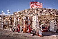 Cool Springs camp along in western Arizona was built in the mid-1920s and was a major stop on Route 66. In the mid-1960s a fire burned cool Springs to the ground leaving only parts of the stone foundation and pillars. In 2001  Ned Leuchtner  purchased the property of Cool Springs and began to restore the old station, which serves as a museum and gift shop for route 66 travelers.