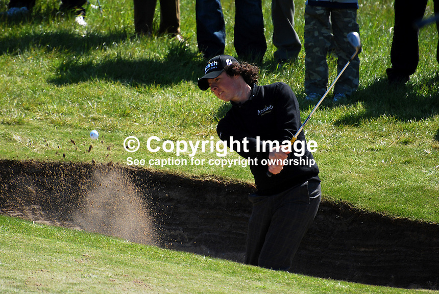Rory McIlroy, professional golfer, N Ireland, UK, plays a bunker shot. 200905122268..Taken at the Irish Open practice day, Tuesday, 12th May, 2009, at Baltray...Copyright Image from Victor Patterson, 54 Dorchester Park, Belfast, UK, BT9 6RJ..Tel: +44 28 9066 1296.Mob: +44 7802 353836.Voicemail +44 20 8816 7153.Skype: victorpattersonbelfast.Email: victorpatterson@mac.com.Email: victorpatterson@ireland.com (back-up)..IMPORTANT: If you wish to use this image or any other of my images please go to www.victorpatterson.com and click on the Terms & Conditions. Then contact me by email or phone with the reference number(s) of the image(s) concerned.