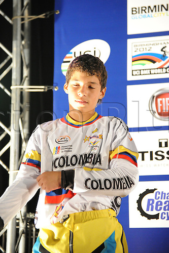 05.27.2012. England, Birmingham, National Indoor Arena. UCI BMX World Championships. Carlos Javier Zuluaga Melo (Colombia) on the podium receiving 1st prize for the Cruisers Boys 12 and under Finals at the NIA ....