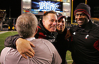 PITTSBURGH, PA - NOVEMBER 05:  Head coach Butch Jones of the Cincinnati Bearcats embraces his coaches following their win against the Pittsburgh Panthers on November 5, 2011 at Heinz Field in Pittsburgh, Pennsylvania.  (Photo by Jared Wickerham/Getty Images)