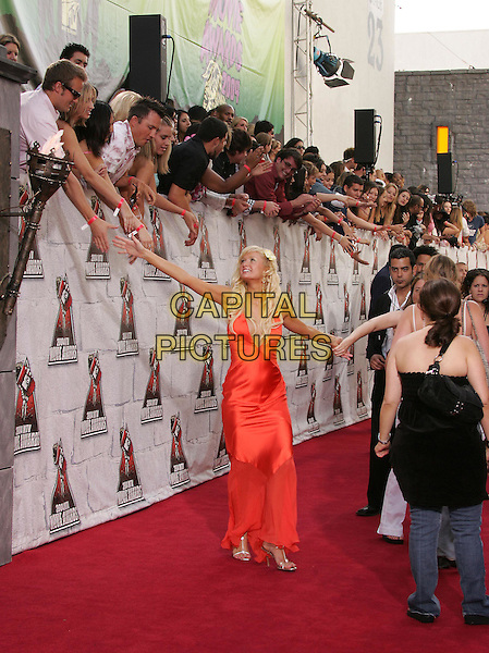 PARIS HILTON.at the 2004 MTV Movie Awards held at The Sony Picture Studios in Culver City, .California,.June 6th 2004.full length full-length long orange dress low cut flower in hair silver t bar sandals heels holding hands with crowd.*UK sales only*.www.capitalpictures.com.sales@capitalpictures.com.©Capital Pictures