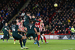 John Egan of Sheffield United heads the ball at goal during the Premier League match at Bramall Lane, Sheffield. Picture date: 5th December 2019. Picture credit should read: James Wilson/Sportimage