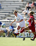 Carolyn Ford (l), of Duke, sends a cross past Maryland's Lauren Krasko (r) on Sunday, October 16th, 2005 at Duke University's Koskinen Stadium in Durham, North Carolina. The Duke University Blue Devils defeated the University of Maryland Terrapins 1-0 during an NCAA Division I Women's Soccer game.
