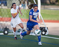 In a National Women's Soccer League Elite (NWSL) match, the Boston Breakers defeated the Western New York Flash  2-1, at Dilboy Stadium on May 5, 2013.    Heather O'Reilly rushes to control the ball near the Flash goal with Western New York Flash defender Katherine Reynolds (16) in pursuit.