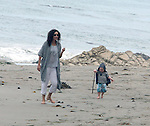 ...June 12th 2010  Exclusive..Minnie Driver was dancing & making up some funny dances while she was marching around & lifting her legs up really high to make her kid laugh. Minnie was teaching her baby kid Henry how to play fetch with there dog on the beach.  Baby Henry was walking around like a mini Yoda with a  hood and walking stick. ...AbilityFilms@yahoo.com.805-427-3519.www.AbilityFilms.com