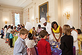 First Lady Michelle Obama joins children in making Mother's Day gifts in the State Dining Room of the White House in Washington, D.C., May 10, 2012. .Mandatory Credit: Sonya N. Hebert - White House via CNP