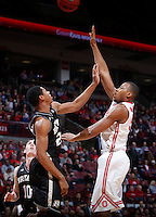 Ohio State Buckeyes center Trey McDonald (55) is guarded by Bryant University Bulldogs forward Dan Garvin (22) during Wednesday's NCAA Division I basketball game at Value City Arena in Columbus on December 11, 2013. (Barbara J. Perenic/The Columbus Dispatch)