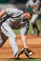 Baylor Bears third baseman Cal Towey #18 charges a ground ball during the NCAA baseball game against the California Golden Bears on March 1st, 2013 at Minute Maid Park in Houston, Texas. Baylor defeated Cal 9-0. (Andrew Woolley/Four Seam Images).