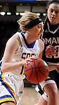SIOUX FALLS, SD - MARCH 7:  Madison Guebert #11 of South Dakota State drives past Omaha defender Carolina Hogue #30 in the 2016 Summit League Tournament. (Photo by Dave Eggen/Inertia)