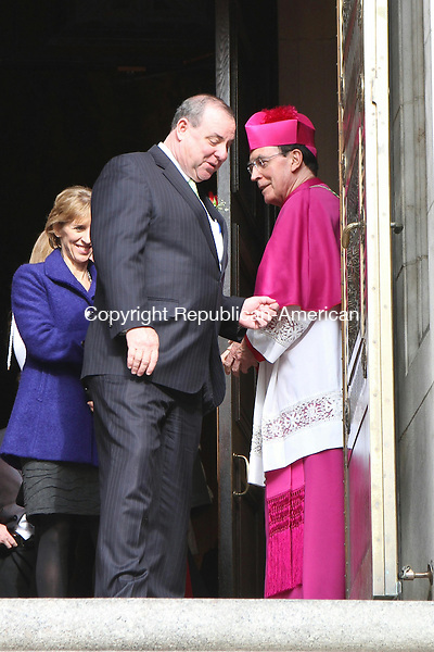 WATERBURY, CT-01 December 2013-120113LW06 - Waterbury Mayor Neil O'Leary, left, chats with Archbishop Henry J. Mansell outside the Basilica of the Immaculate Conception Sunday after a mass to celebrate his inauguration. Laraine Weschler Republican-American