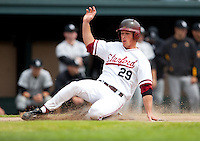 STANFORD, CA - March 27, 2011: Ben Clowe of Stanford baseball slides safely into home during Stanford's game against Long Beach State at Sunken Diamond. Stanford won 6-5.