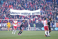 """HARRISON, NJ - Sunday March 22, 2015: Fans of the South Ward display a """"Legends Deserve Better Sign.""""  The New York Red Bulls defeat DC United 2-0 in their home opener at Red Bull Arena in 20th season of regular MLS play."""
