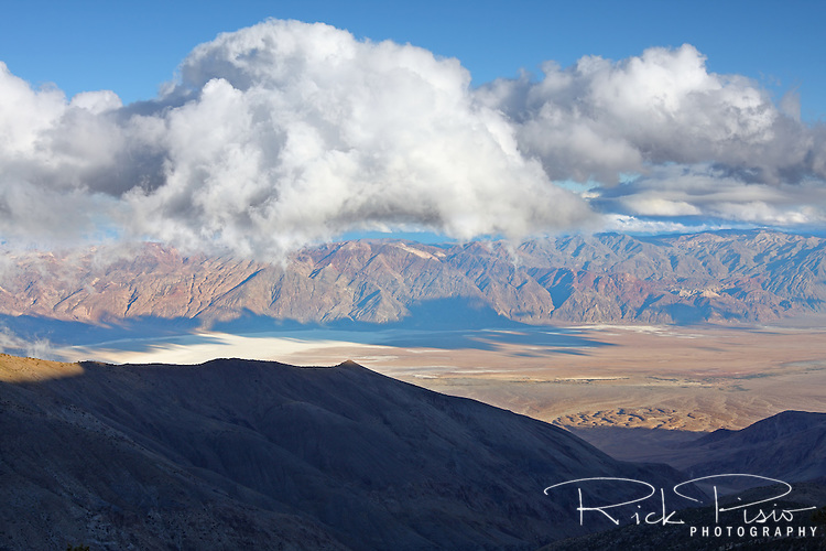 Clouds form over Badwater Basin in Death Valley National Park as seen from Mohogany Flat.