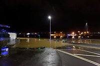 Pictured: The flooded area by the footbridge by the A4242 which runs through the city centre in Carmarthen, Wales, UK. Saturday 13 October 2018<br /> Re: River Towy has burst its banks and adjacent properties have flooded, caused by storm Callum, in Carmarthen, west Wales, UK.